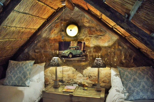 Thatch roof,sandstone walls,cosy bedroom in loft